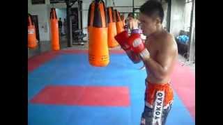 Current WBC Muaythai World Superwelterweight Champion Kem Sitsongpeenong on the bag...