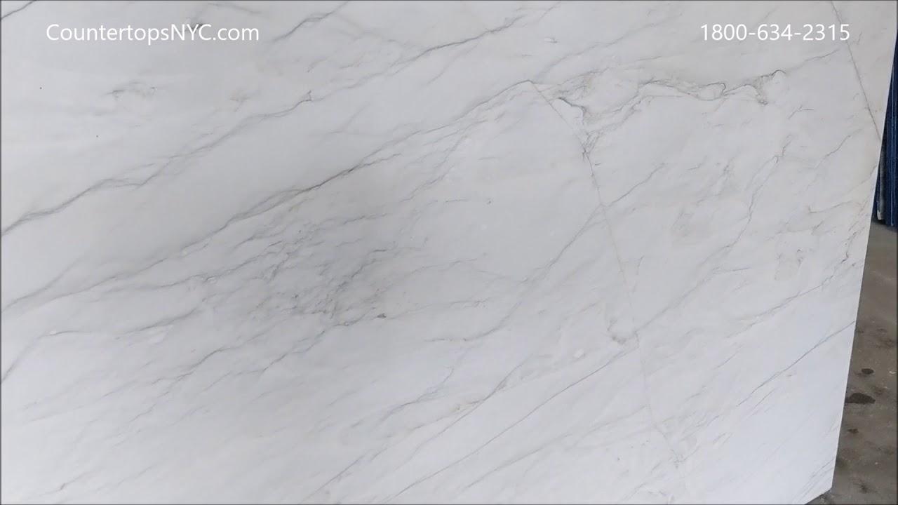 Calacatta quartzite slabs for kitchen countertop NYC - YouTube