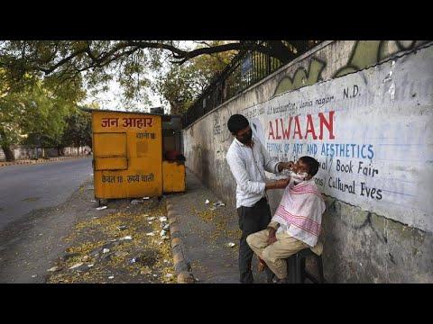 Hindistan'da Covid-19: Yasakların ardından berberler yeniden iş başında