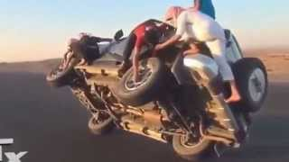 crazy people at Saudi Arabia changing car tires when the driving