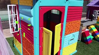 girl in colourful toy house