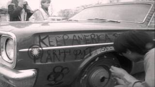 Anti hate people gather at the Belle Isle park write peace slogans on cars, dance...HD Stock Footage