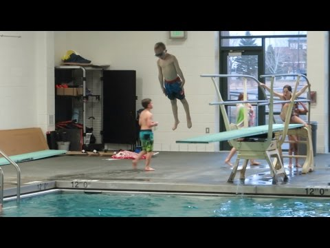 Swim class kids jumping and diving