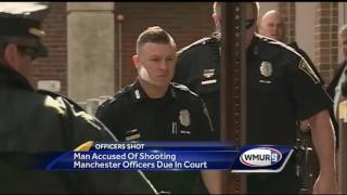 Officers shot in Manchester arrive ahead of accused gunman's arraignment