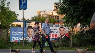 Poland begins voting in presidential election delayed by Covid-19