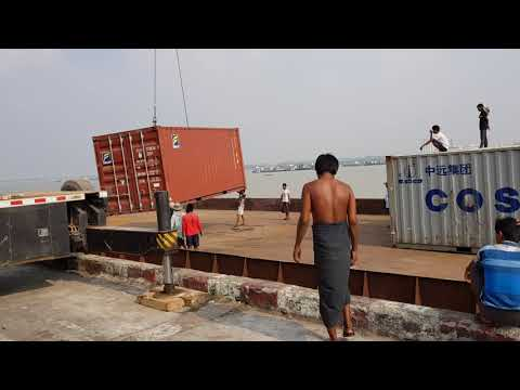 Loading Empty Containers to Our Barge at TharKayTa Jetty.