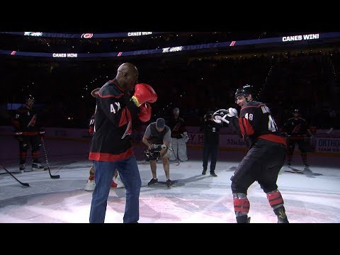 Evander Holyfield puts the gloves on to celebrate the Hurricanes' victory