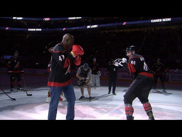 Evander Holyfield puts the gloves on and goes toe-to-toe with Jordan Martinook at center ice to celebrate the Hurricanes' win against the Blues