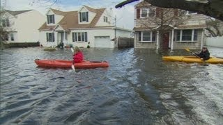 New York residents return to flooded homes