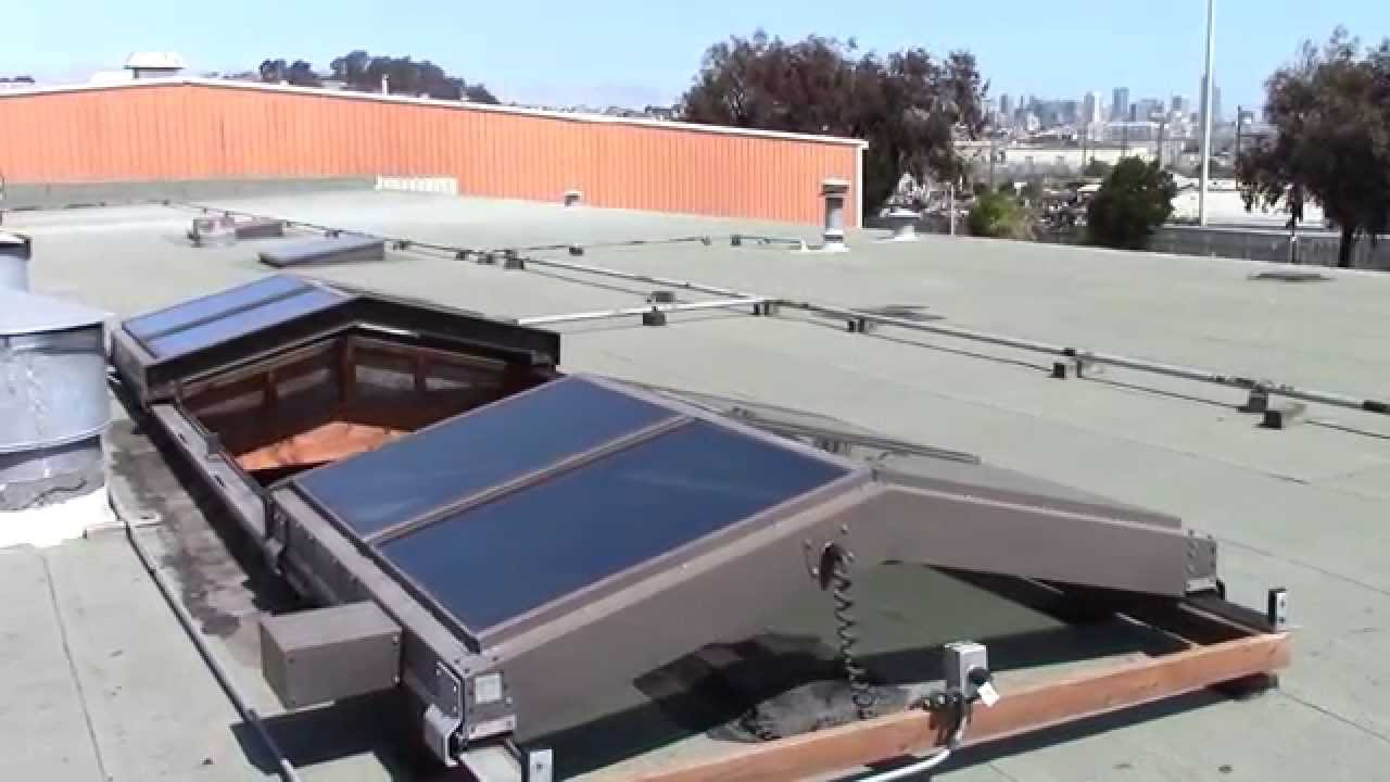 Rollamatic Saddle Ridge Retractable Skylight On A Flat