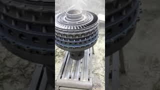 Sandblasting a titanium Tornado Jet engine.
