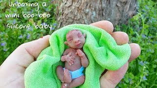Unboxing A Miniature Silicone Baby...(with boo-boo's)