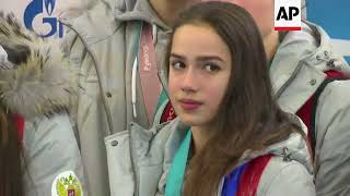 Russian athletes return home after taking part in Winter Olympics
