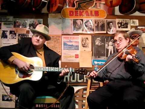 "David Peterson & Michael Cleveland perform ""He Hideth My Soul"""