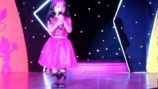 "Sacha singing a medley of ""We are the world"" and ""Let it be"" at Kidzania Superstarz 2013 Finals"