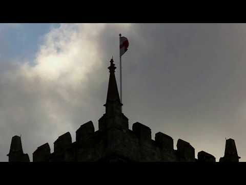 English Flag flutters on tower of St Peter's Church ruin - Bristol, UK