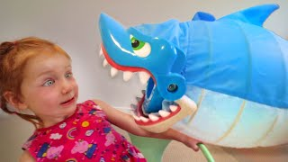 DON'T GET CAUGHT!! Adley reviews Shark Bite pool toy with Mom (mystery guest)