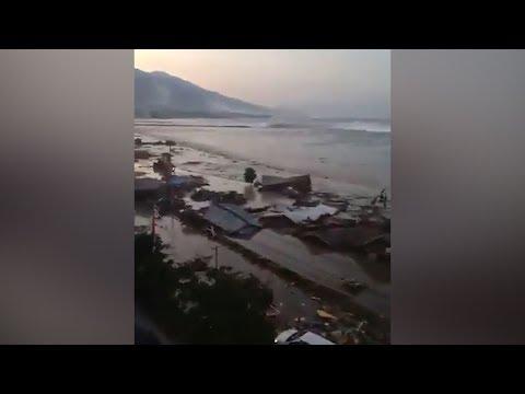 Video shows tsunami hitting Indonesian city after 7.5-magnitude quake