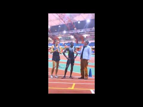 Lopez Lomong talks (with Chris Derrick) after setting the indoor 5000 American record at13:07.00