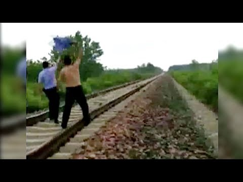 Thrilling Moment: Police Officer Stops A Train Crash