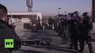 St. Louis riot police pepper spray protesters blocking highway
