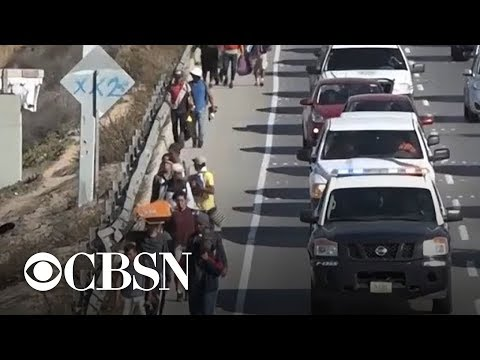 Migrants seeking asylum arrive at U.S. border