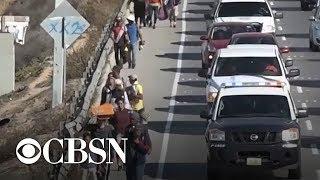 Migrants seeking asylum arrive at U.S. border