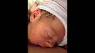 One day old newborn breastfeeding