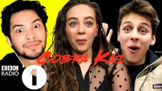 """Do you watch Cobra Kai?!""  Xolo Maridueña, Mary Mouser & Jacob Bertrand on fans and fights"
