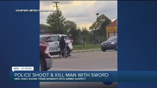 Video: Man charges at Detroit police with sword