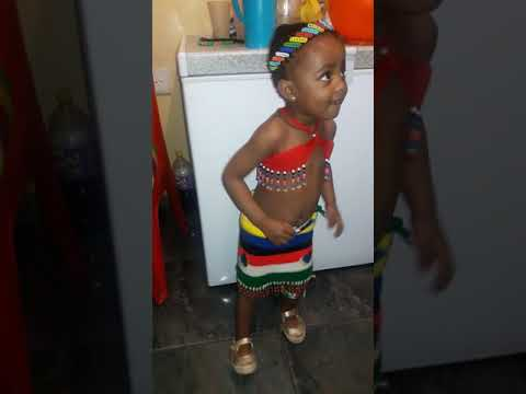 A young Zulu woman dancing traditional dance
