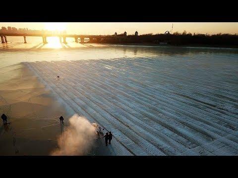 Ice harvesting begins for the Harbin ice festival