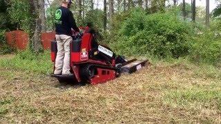 Crewcutservices.com Toro dingo tx1000 mini skid steer with quick attach brush mower. Mowing brush.
