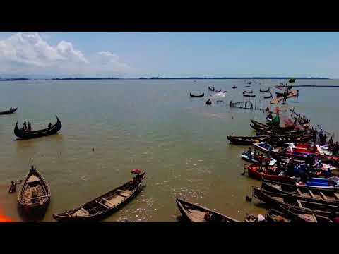 Drone footage Fisherman on The Bay Of Bengal help Rohingya onto mainland