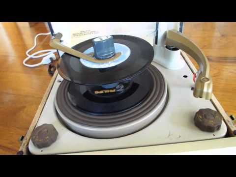 Decca record player playing a stack of 45 RPM records