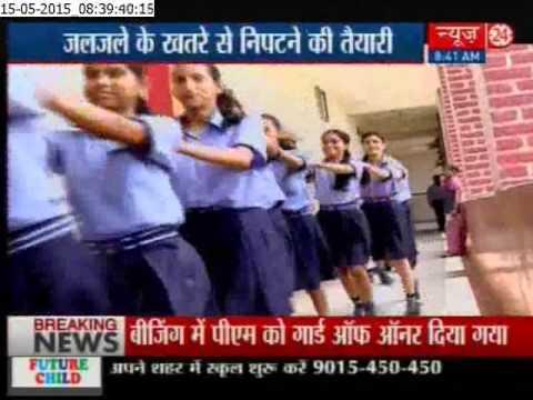School students do a mock earthquake drill in Noida