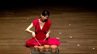 to the earth for speaking percussionist