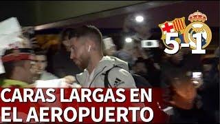 Caras largas de los jugadores del Madrid en el aeropueto | Diario AS