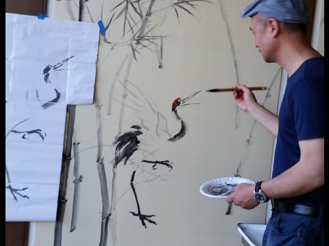 Henry Li Painting a Crane on Silk Panel in Symphony Tower Social Room