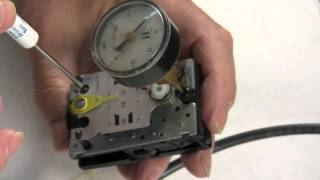 How to Calibrate a pneumatic thermostat