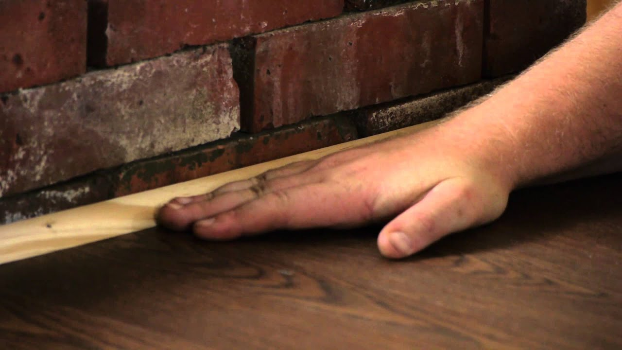 finishing a laminate floor next to brick flooring projects youtube