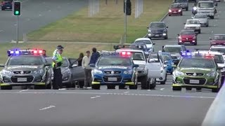 Police stop traffic and clear people from the bridge for RAAF F/A-18 training exercise in Canberra