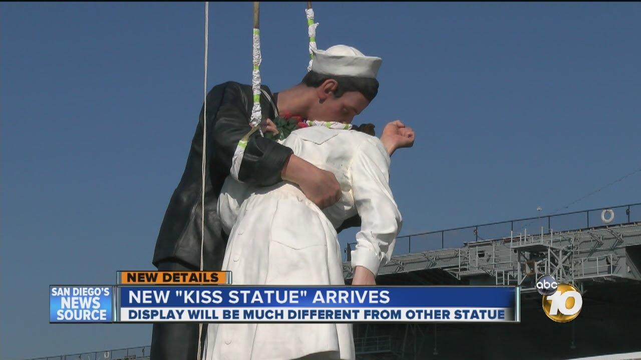 Navy guy kissing nurse