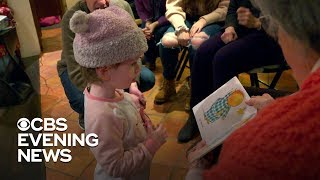 Community learns sign language to engage with 2yearold girl