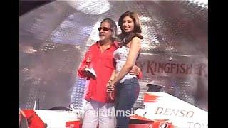 Vijay Mallya and Shilpa Shetty pop champagne at Toyota Formula 1 replica car launch