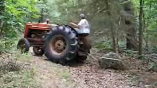 Antique Farm Tractor vs Landscape Rock