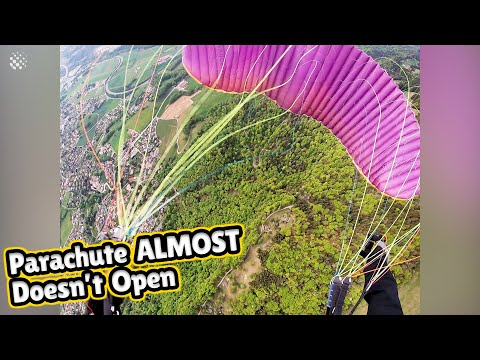 Watch this near fatal paragliding moment where chute ALMOST doesn't open.