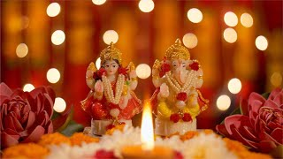 Diwali puja - Ganpati and Lakshmi Ji idol with diya lamp for pujan with bokeh effect