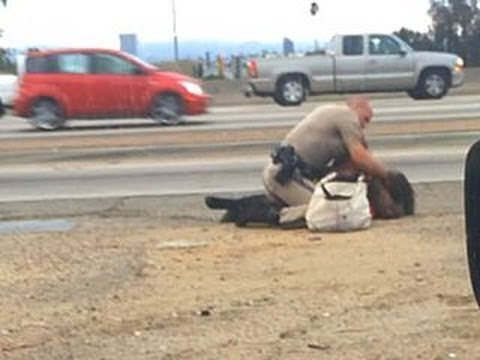CHP officer under fire for beating woman on roadside