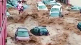 video: Watch:Severe flooding sweeps cars away in Belgium
